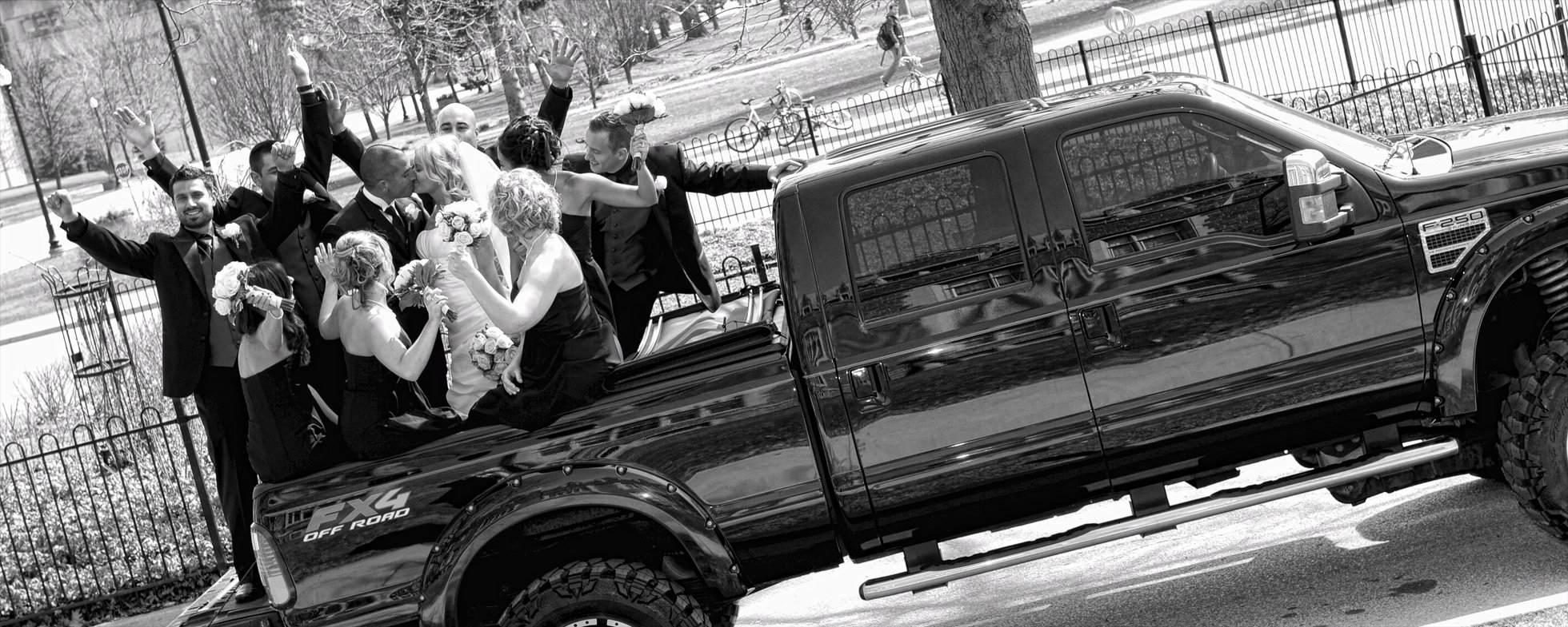 wedding party in a pick up truck