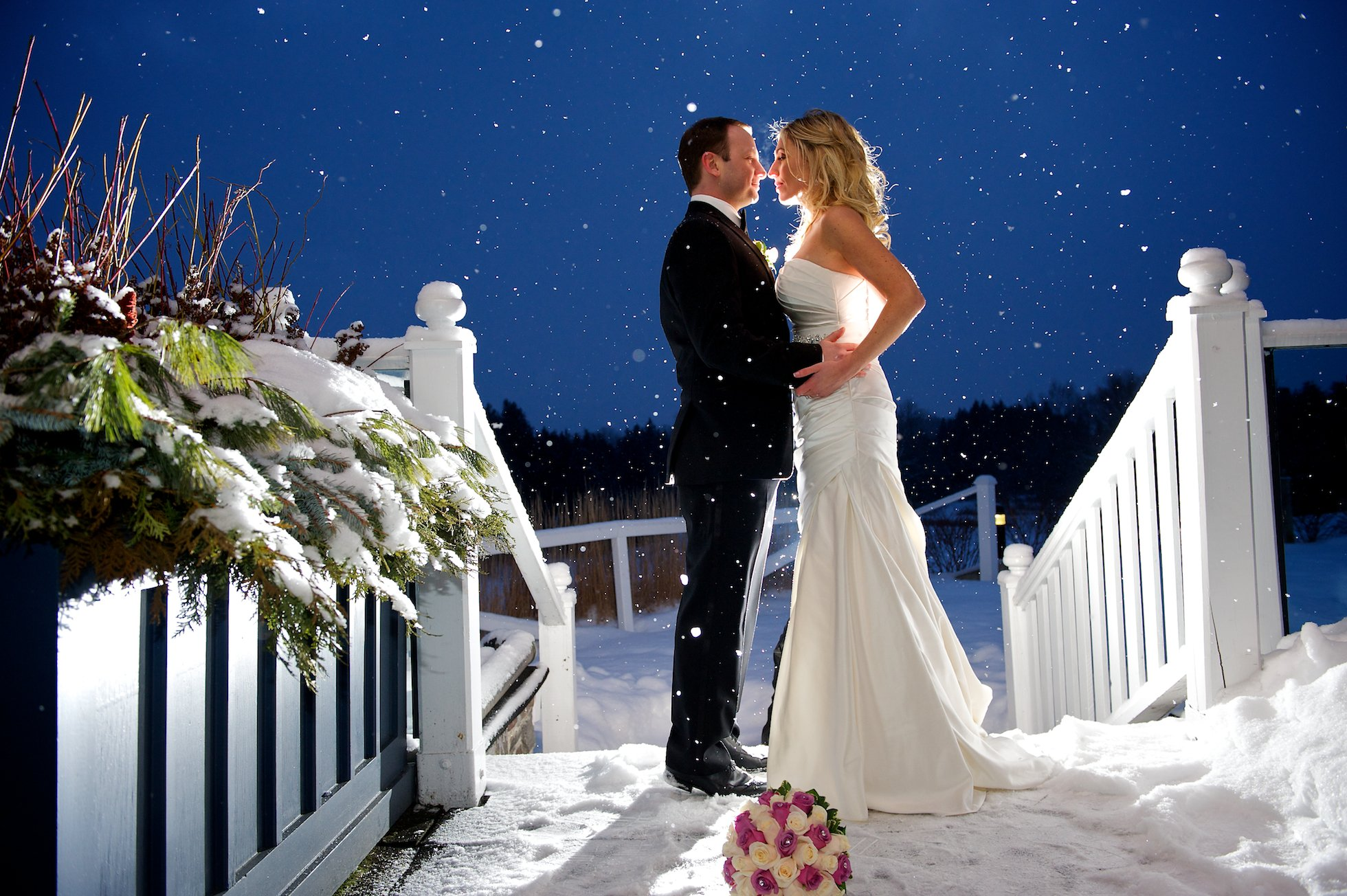 Winter wedding kiss